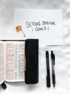 Open Bible with pens