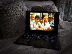 Anne of Green Gables and Gilbert on open laptop in bed