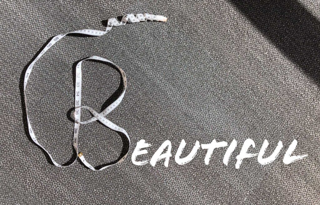 "Letter ""B"" made with a measuring tape. The rest of the word ""beautiful"" spelt out win letters."