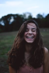Girl laughing hair blowing in the wind