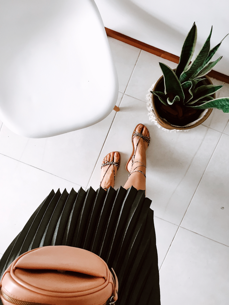 Pleated skirt, sandals, white tiled floor