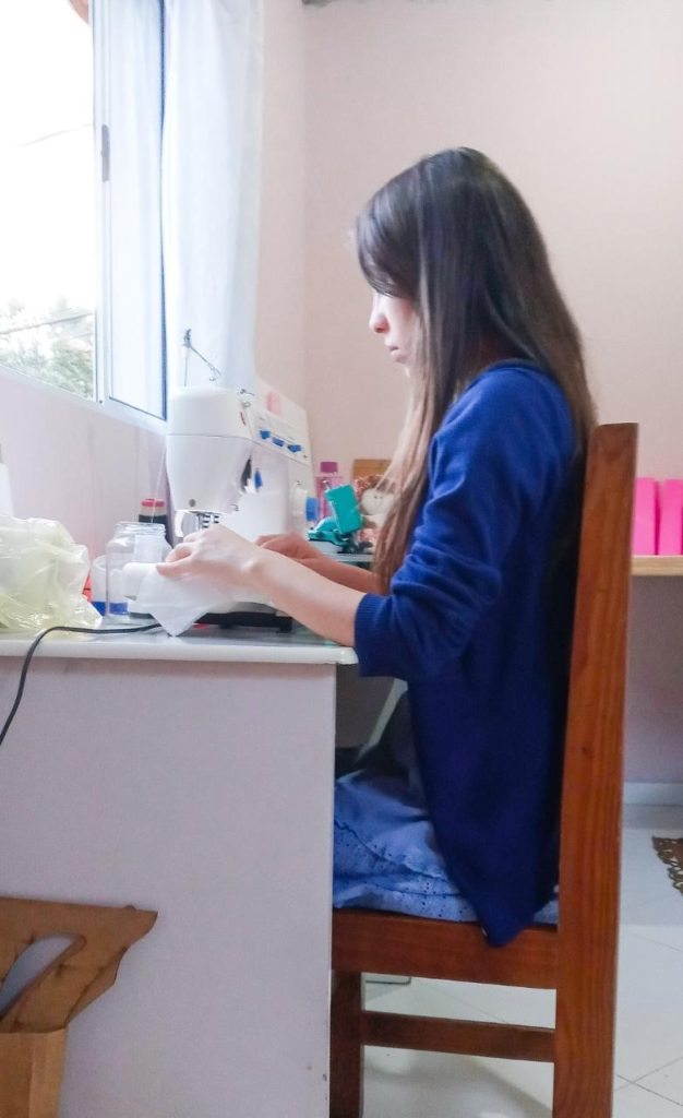 Seamstress at work sits in chair