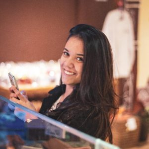 Profile picture of a woman at a counter